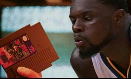 Lance blowing into a Nintendo cartridge